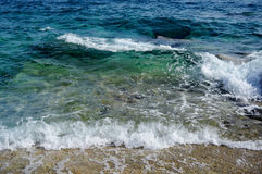 Sea wave and sandy beach Stock Images