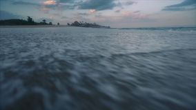 Sea wave on the sandy beach. Hand held camera stock footage