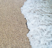 Sea wave and sandy beach. Sea wave and yellow sandy beach background Royalty Free Stock Photos