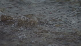 Sea Wave Shake The Sand At Evening stock video