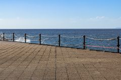 Sea wave slamming on the embankment. Of the coastline Royalty Free Stock Image