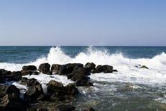 Sea wave splash. To the rock Stock Image
