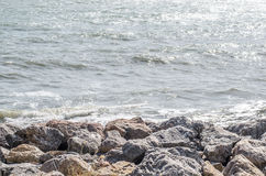 Sea wave splashing on rock Stock Images