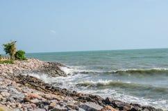 Sea wave splashing on rock Stock Photos