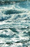 Sea wave splashing water.Blue blue photo. Sea wave splashing water. Blue blue photo. Sunny bunnies glisten on the surface of the water stock photos