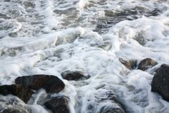 Sea wave on the stones royalty free stock images