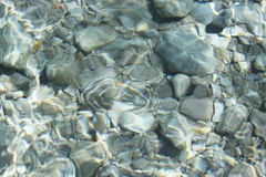 Sea wave and stones floor - abstract background Stock Photos