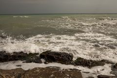 Sea wave - a the storm begins. Beach overview of the Black Sea beach - the storm begins stock image