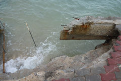 Sea wave strong eroded the wall. Sea wave is strong eroded royalty free stock photos