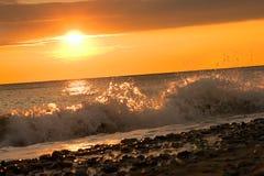 Sea surf at sunset Stock Photo