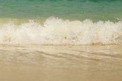 Sea wave swash on sand beach.  Stock Photo