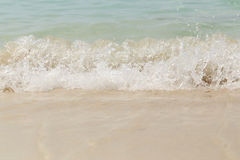 Sea wave swash on sand beach Royalty Free Stock Photo