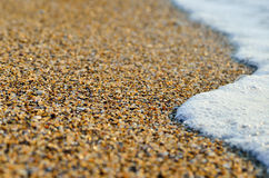 Sea wave washes over stones on the beach Royalty Free Stock Photography