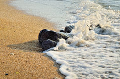 Sea wave washes over stones on the beach Stock Photos