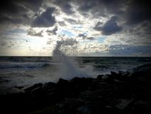 Sea wave. S breaking on the breakwater Royalty Free Stock Image