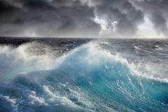 Sea wave. Waves Breaking and Spraying at High Seas and Strong Winds Royalty Free Stock Photos