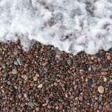 Sea wave and wet stones. Texture Stock Photo