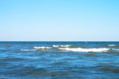 Sea wave with white spray, horizon. Blue sky. Azov. Ukraine Stock Images