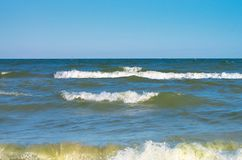 Sea wave with white spray, horizon. Blue sky. Sea of Azov. Ukraine Stock Images