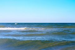 Sea wave with white spray, horizon. Blue sky. Azov. Ukraine Royalty Free Stock Images