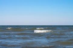 Sea wave with white spray, horizon. Blue sky. Azov. Ukraine Royalty Free Stock Photography