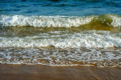 Sea waves affecting the sandy beach, energetic sea waves, relaxi Stock Photo