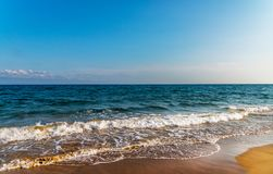Sea waves affecting the sandy beach, energetic sea waves, relaxi Royalty Free Stock Photography