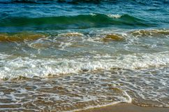Sea waves affecting the sandy beach, energetic sea waves, relaxi Stock Image