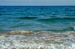 Sea waves affecting the sandy beach, energetic sea waves, relaxi Royalty Free Stock Photos