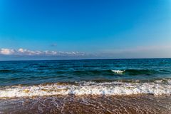 Sea waves affecting the sandy beach, energetic sea waves, relaxi Stock Images