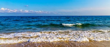 Sea waves affecting the sandy beach, energetic sea waves, relaxi Stock Photography