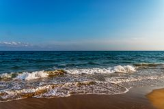 Sea waves affecting the sandy beach, energetic sea waves, relaxi Royalty Free Stock Image