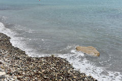 Sea waves approaching pebble stones Stock Photo