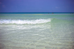 Sea waves in azure water at the blue sky Royalty Free Stock Photo