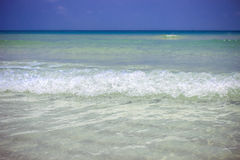 Sea waves in azure water at the blue sky Royalty Free Stock Photos