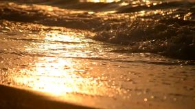 Sea waves on the beach at sunset, dawn close-up, low angle. View from below stock video