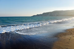 Sea waves and beach at sunset Stock Photography