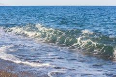 Sea waves on the beach stock image