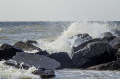 Sea waves beat about rocks Royalty Free Stock Photo
