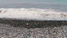 Sea waves beat on stony shore on the embankment of the Georgian city resort of Batumi stock video footage