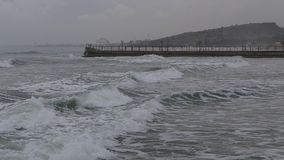 Sea waves beating against the rocks of the pier. stock footage