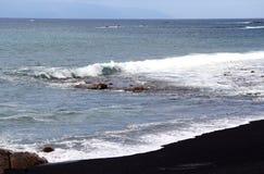 Sea waves on the black beach Stock Image