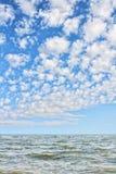 Sea waves and blue cloudy sky. Stock Photos
