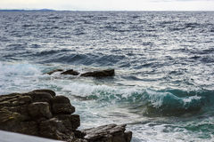 Sea waves blue and green. Green and blue sea waves crushing on rocks Royalty Free Stock Photos