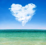 Sea waves and blue sky with cloudy heart Royalty Free Stock Photography