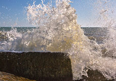 Sea waves break with spray and foam. Closeup Stock Photos