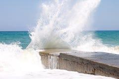 Sea waves breaking on a breakwater Stock Image