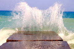 Sea waves breaking on the breakwater Royalty Free Stock Images