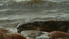 Sea waves breaking. On coastal cliffs, slow motion stock video