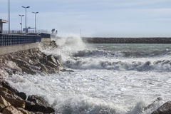 Sea waves breaking on concrete port Royalty Free Stock Images